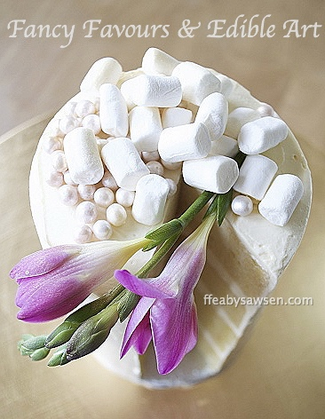 Sawsen's eggless Swiss meringue buttercream SEBC on a mini cake with marshmallows & freesia