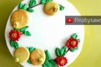 buttercream pomegranate fruit & blossom flower wreath cake tutorial | ffeabysawsen.com